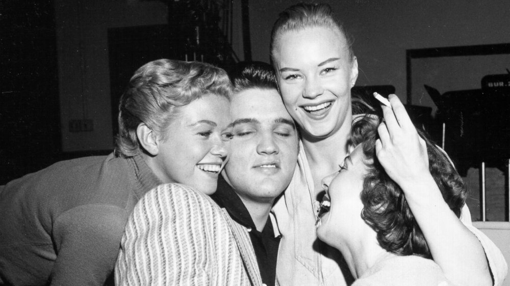 "Elvis Presley is mobbed by girls on the set of the ""Milton Berle Show"" in 1956."