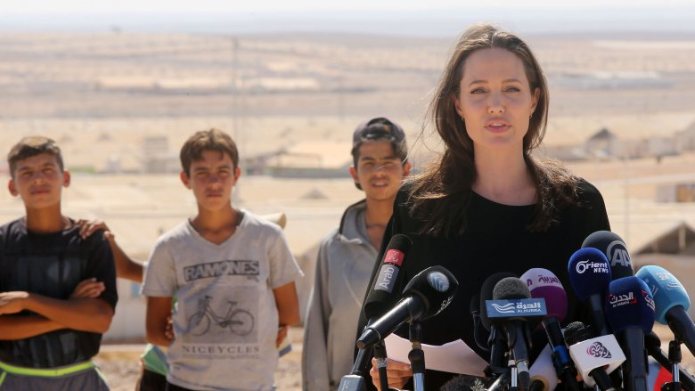 Angelina Jolie speaking during a field mission