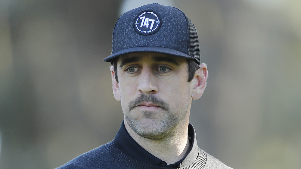 Aaron Rodgers looking somber at the AT&T Pebble Beach Pro-Am