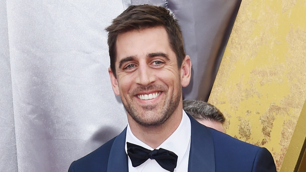 Aaron Rodgers smiling at the 88th Annual Academy Awards