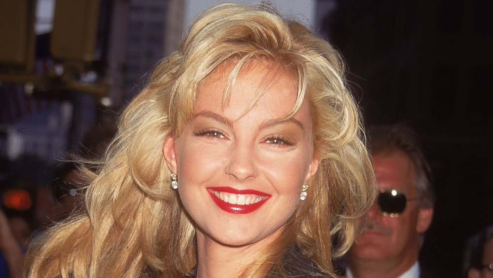 A young, blonde-haired Ashley Judd smiling
